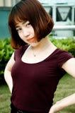 En kinesisk flicka i trädgården Royaltyfria Foton