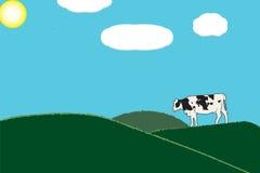 En ko i grönt gräs betar Fotografering för Bildbyråer