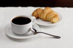 En kopp kaffe och en giffel Royaltyfri Bild