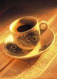 En kopp kaffe på materielindex Arkivbild