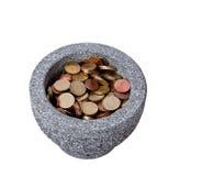 En kopp som är full av cents Royaltyfri Fotografi