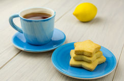 En kopp te och en efterrätt Royaltyfria Foton