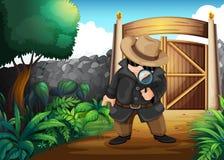 En kriminalare på trädgården Arkivbild