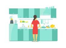En kvinna i disken för kökförberedelsemat och tabellen och köksskåpen för bordsserviskastrullbordsservis Arkivbild