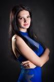 En kvinna i en blå klänning Royaltyfria Foton