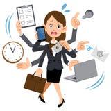 En kvinna som arbetar på ett företag som är för upptaget stock illustrationer