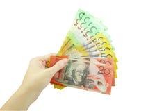 En kvinnas hållande pengar för hand fotografering för bildbyråer