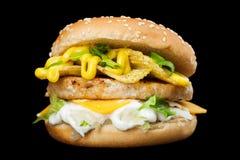 En läcker hamburgare Royaltyfri Bild
