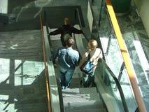 En la escalera móvil Imágenes de archivo libres de regalías
