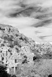 en la montaña de Omán la casa y el cl abandonados viejos del arco del pueblo Foto de archivo libre de regalías