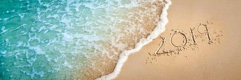 2019 en la playa fotos de archivo