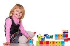 Barndom av en liten flicka royaltyfri fotografi