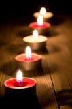 En linje av burning stearinljus Fotografering för Bildbyråer