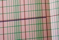 En linje på papper Arkivfoto