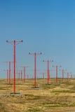 Ljus flygplatslandning står hög Arkivbild