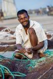 En lycklig fiskare på att arbeta Royaltyfri Bild