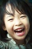 En lycklig liten flicka Arkivbild