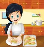 En lycklig moder som förbereder mellanmål i köket royaltyfri illustrationer