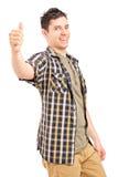 En lycklig ung manlig som ger upp en tum Arkivbilder