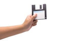En mänsklig hand som rymmer en svart 3 5 tum manetic diskettisolat Arkivbilder