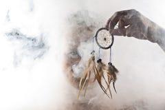 En man i abstrakt rök fotografering för bildbyråer