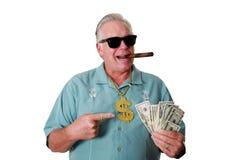 En man med pengar En man segrar pengar En man har pengar En man sniffar pengar En man älskar pengar En man och hans pengar En man Royaltyfri Foto