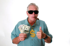 En man med pengar En man segrar pengar En man har pengar En man sniffar pengar En man älskar pengar En man och hans pengar En man royaltyfria bilder