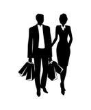 En man och en kvinna går med shopping Royaltyfri Foto