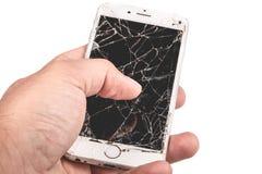 En man rymmer i hans hand en iphone 6S av Apple Inc royaltyfri fotografi