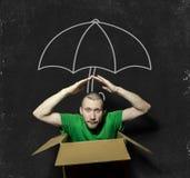 En man sitter i en förorsaka kramp i ask Fotografering för Bildbyråer
