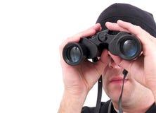 En man som använder isolerad kikare royaltyfria foton