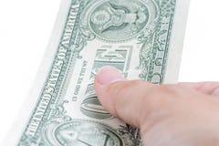 En manhand som betalar en US dollar räkningar på vit bakgrund, busin Arkivfoton