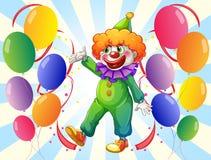 En manlig clown i mitt av ballongerna Royaltyfri Bild