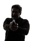 Manmördarepolis som siktar vapensilhouetten Arkivbild