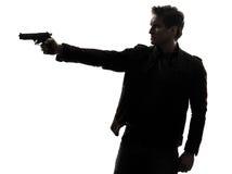 Manmördarepolis som siktar vapensilhouetten Fotografering för Bildbyråer