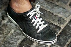 En mans fot och sko royaltyfri foto