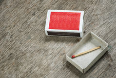 En match i asken Arkivbilder