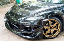 En Mazda RX8 bär kant för Volk strålar TE37 guld- 18 tum Royaltyfria Bilder