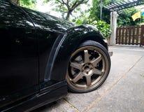 En Mazda RX8 bär kant för Volk strålar TE37 guld- 18 tum Fotografering för Bildbyråer