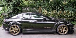 En Mazda RX8 bär kant för Volk strålar TE37 guld- 18 tum Arkivbilder