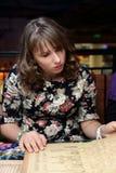 En menú de mirada adolescente Fotografía de archivo libre de regalías