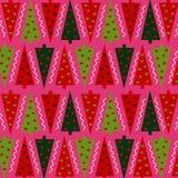En modell av julgranar på en rosa bakgrund Modell för inpackningspapper och olika bakgrunder Royaltyfria Bilder
