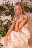 En modell som poserar under Claire Pettibone Four Seasons Collection, ställer ut Arkivfoton