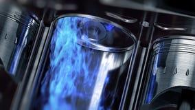En närbild av motorn i ultrarapid med blåa explosioner av bränsle