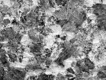 En närbild av en textur av en polerad grå granitstenyttersida Royaltyfri Fotografi