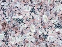En närbild av en textur av en ros polerade granityttersida Arkivfoton
