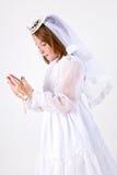 Ung flicka första nattvardsgång royaltyfri foto