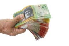 En näve mycket av pengar Arkivfoton