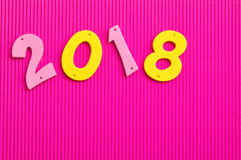 2018 en números rosados y amarillos Foto de archivo libre de regalías