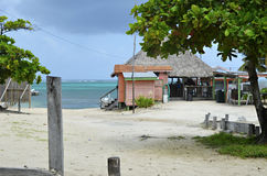 En oceansidestång i San Pedro, Belize Arkivfoto